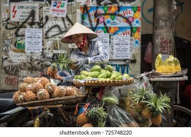 Hanoi, Vietnam - April 13, 2017: Local street vendor on city center of Hanoi, Vietnam