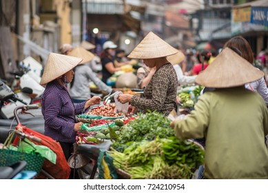 Hanoi, Vietnam - April 14, 2017: Local street vendors on city center of Hanoi, Vietnam