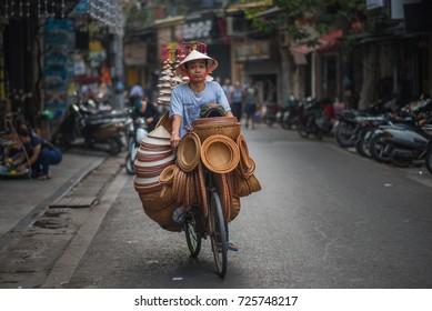 Hanoi, Vietnam - April 14, 2017: Local street vendor on city center of Hanoi, Vietnam