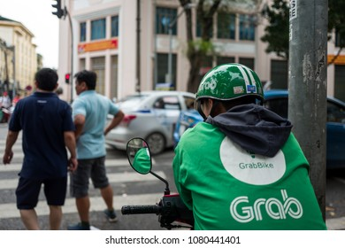 Hanoi, Vietnam - April 15, 2018: Grab driver waits for Clients on the streets of Hanoi.