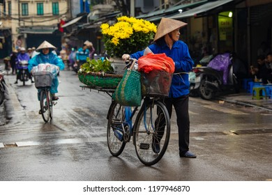 HaNoi, Vietnam - April 16,2018: Street sellers of HaNoi city.Most of the street sellers use bicycle to sell their product like fruits,flowers or other tools needed at home.
