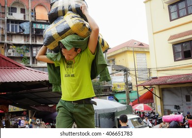 Hanoi, Vietnam, April 28, 2015: A labour carrying goods at a market in Hanoi