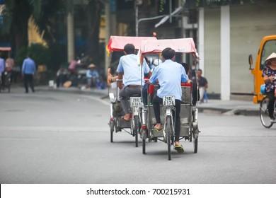 Hanoi, Vietnam, Aug 19 2017: Life in vietnam- Cyclo beside Sword lake in hanoi, vietnam. Cyclo is the tourist's farvourite vehicle transportation in vietnam