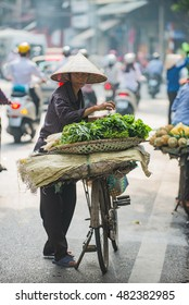 Hanoi, Vietnam, Aug 30, 2016: Life in Vietnam. An unidentified Street vendors. They sell everything from flower, fruits, handicraft goods, bamboo and rattan goods to food.