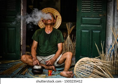 Hanoi, Vietnam - August 10, 2019 : Fish trap village  wicker craftsman making traditional bamboo fish trap  weaving from  bamboo strips in  Hung Yen, Hanoi, Vietnam