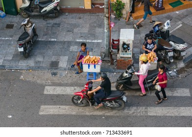 Hanoi, Vietnam - August 12, 2017: Street food vendors selling bread rolls on sidestreet in Hanoi. View from above