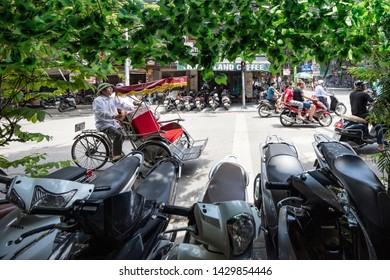 Hanoi Vietnam August 18th 2018 : A tricycle (or cyclo) riding along looking for customers on a busy street in Hanoi, Vietnam