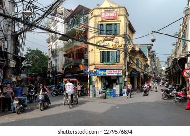 Hanoi, Vietnam - Busy street corner and Street market in old town during day time December 23, 2018 Hanoi Vietnam.