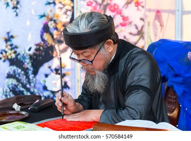 HANOI, VIETNAM - DEC 17: Calligraphers are writing ancient letter for everyone with wishing health,love, wealth, happiness, December 17, 2016 in Hanoi, Vietnam. This is tradition art vietnamese gift.