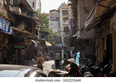 Hanoi, Vietnam - Dec 18, 2017: Busy motorbike traffic and street food in the Old Quarter in Hanoi.