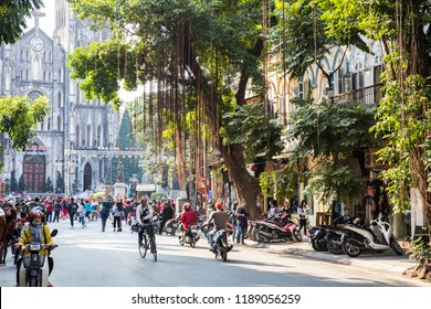 Hanoi Vietnam - Dec 2017: A crowd and busy traffic during day time on the Christmas eve day in front of St Joseph Cathedral