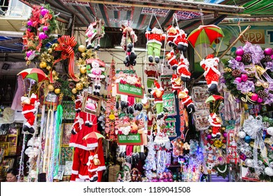 Hanoi Vietnam - Dec 2017: A variety of decorative goods for Xmas including Parachuting Santa Claus doll displayed at the local store in the old quarter