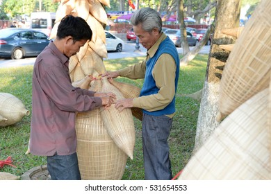Hanoi, Vietnam - Dec 7, 2016:Crafts exhibition.Handicraft products made from bamboo and other natural materials popular in Vietnam delta. This item is used to catch fish and other aquatic organisms.