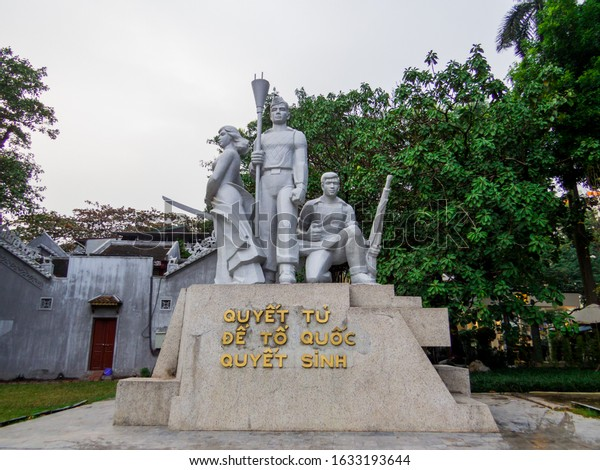 """Hanoi, Vietnam - December 19, 2019: Monument on Hoan Kiem Lake. Vietnamese text: """"Determined to die for the Fatherland""""."""