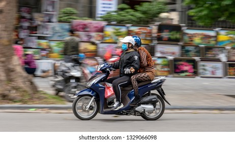 Hanoi / Vietnam - December 2018: Motor cycles at Hanoi street. The main means of transport within Hanoi city are motorbikes.