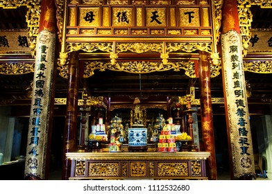 HANOI, VIETNAM - DECEMBER 31, 2017: A golden chinese temple in the heart of hanoi where people from Vietnam comes to pray