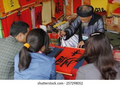 Hanoi Vietnam Scholar Writes Chinese Calligraphy Stock Photo