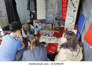 HANOI, VIETNAM, FEB 20 Old master is writing ancient letter for everyone in lunar new year on February 20, 2015 in Hanoi, Vietnam. This is a tradition of vietnamese people in lunar new year