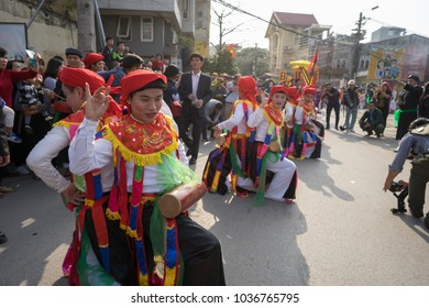 Hanoi, Vietnam - Feb 5, 2017: Men with women dress performing ancient dance called Con Di Danh Bong - Prostitutes beat the drum at spring festival in Trieu Khuc village.