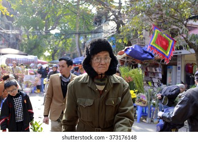 hanoi, vietnam, Feb 6 2016: daily life in Pho Co Hanoi. people in Hanoi's Old Quarter are busy preparing for the Lunar new year festival. Tet is the most important celebration in Vietnamese culture