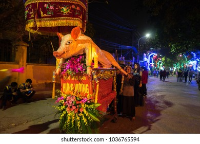 Hanoi, Vietnam - Feb 9, 2017: Pig procession festival in La Phu village. People wearing formal uniform and going from the main path of the village to the temple.