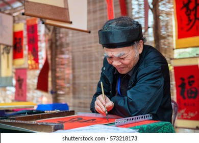 Hanoi, Vietnam - February 03, 2016: The old master is writing ancient letter in lunar new year