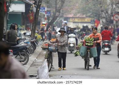 Hanoi, Vietnam, February 15, 2015: Life in Vietnam- Hanoi,Vietnam Street vendors in Hanoi's Old Quarter( Pho Co Hanoi)
