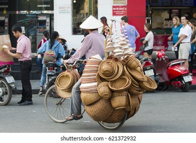 Hanoi, Vietnam - February 16, 2017: An unidentified  Street vendors. They sell everything from flower, fruits, handicraft goods, bamboo and rattan goods to food.