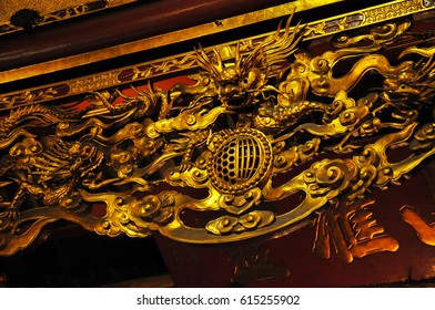 HANOI, VIETNAM - FEBRUARY 19, 2013: The golden interior of the Bach ma temple in Hanoi was decorated in the Medieval period