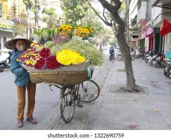 HANOI, VIETNAM - FEBRUARY 19, 2017: Interesting flowers shop on the back of a bike on the street of Hanoi