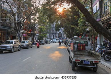 Hanoi, Vietnam: February 21, 2016: Tourists and local people walking in fron of Saint Joseph Cathedral, the most important church of Hanoi