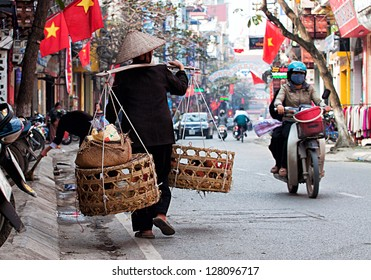 HANOI, VIETNAM - FEBRUARY 3: Unidentified vendor at the small market on February 3, 2013 in Hanoi, Vietnam. This is a small market in Tet Lunar New Year celebrations of vietnam