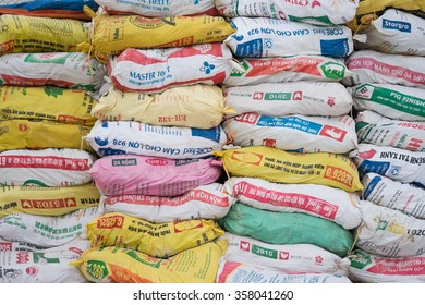 Hanoi, Vietnam - Jan 1, 2016: Many packages of many kinds of animal food for sale at an agricultural store in a rural area. Agriculture is the easiest industry to be hurt in Vietnam by TPP agreement.