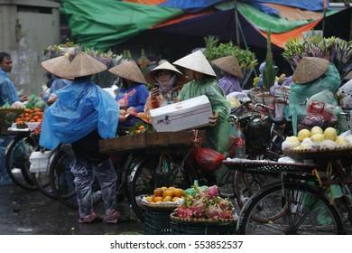 Hanoi, Vietnam Jan 10, 2017: Daily life in Vietnam. Vietnamese Vietnamese Street vendors in Hanoi Old Quarter.