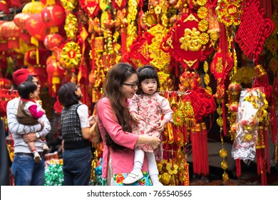Hanoi, Vietnam - Jan 26, 2017: People take a walk buying decoration and flower for Vietnamese lunar new year on Hang Ma street