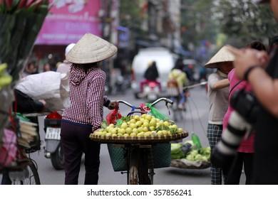 Hanoi, Vietnam, Jan 3, 2016: Street vendor in Hanoi's Old Quarter( Pho co Hanoi), this is culture of Hanoi