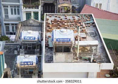 Hanoi, Vietnam - Jan 5, 2016: Water tanks made of stainless steel on top of the roof in Hanoi, Vietnam
