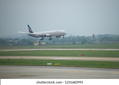HANOI, VIETNAM - JANUARY 12, 2016: The Boeing 777-3M0 (VP-BGC) of Aeroflot airline makes landing on the Noi Bai airport in the gloomy morning