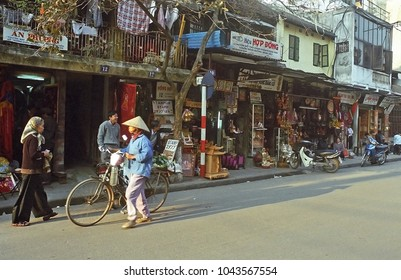 HANOI, VIETNAM – JANUARY 14, 2002: typical street  in the city old quarter. The shops create in the city a great atmosphere.