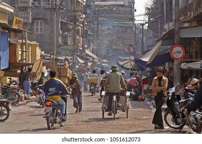 HANOI, VIETNAM – JANUARY 14, 2002: bikes and motor cycles traffic  in the city old quarter. The place is always very crowded.