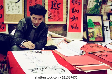 Hanoi, Vietnam - January 17, 2012: The scholar is writing the parallel sentences for Tet holiday