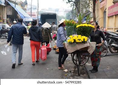 Hanoi VIetnam January 2 2016 Life in Vietnam- Hanoi,Vietnam Street vendors in Hanoi's Old Quarter. Street vendors sell a lot of things, fruits, flowers, personal items, etc..