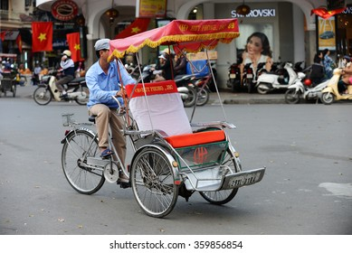 Hanoi, Vietnam - January 8, 2016: Cyclo beside Hoan Kiem lake. Cyclo is the tourist's favorite vehicle transportation and the ancient city tour by cyclo around is very popular with tourists.
