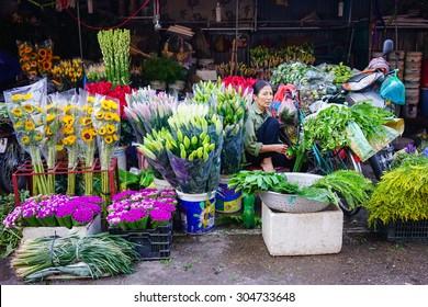 Hanoi, Vietnam - July 12, 2015: Fresh flowers on shop in Quangba Flower Market in Hanoi. Quang Ba market is considered the only flower wholesale market in Hanoi.