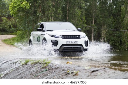 Hanoi, Vietnam - July 13, 2016: Range Rover (Land Rover) Evoque 2016 car crossing water dam on the test road in mountain area in Vietnam.