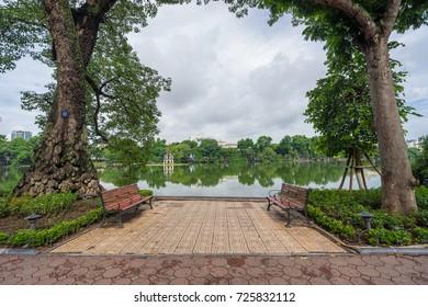 Hanoi, Vietnam - July 19,2017: Park around Hoan Kiem Lake or Sword Lake with Turtle tower  Hanoi, Vietnam