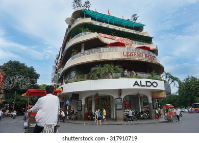 Hanoi, Vietnam - July 27, 2015 : plenty of entertainment in the animated streets of Hanoi with many shops, bicycles, pedestrians and rickshaws.