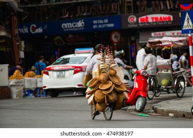 Hanoi, Vietnam, July 27, 2016: Street vendors in Phoco Hanoi (Hanoi's Old Quarter) It is one of some specific cultural features of Hanoi. They sell everything from flowers to foods to anything