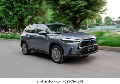 Hanoi, Vietnam - July 29, 2020: Toyota Corolla Cross hybrid car is on the road in road-test, Vietnam.