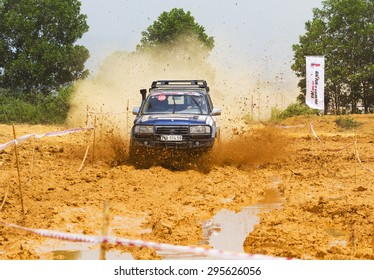 Hanoi, Vietnam - July 4, 2015: Toyota Land Cruiser car doing an circuit of Vietnam Off-road Cup (VOC) in a water road area of Hanoi. VOC is an yearly event for off-road player in Vietnam.